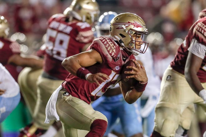 Quarterback Jordan Travis #13 of the Florida State Seminoles on ar run play during the game against the North Carolina Tar Heels at Doak Campbell Stadium on Bobby Bowden Field on October 17, 2020 in Tallahassee, Florida. Florida State upset #5 ranked North Carolina 31 to 28.