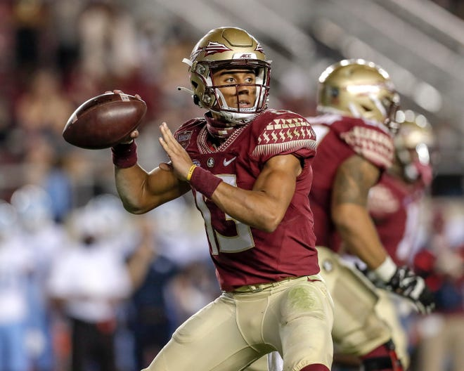 Florida State quarterback Jordan Travis (13) passes during the game against the North Carolina Tar Heels at Doak Campbell Stadium on Bobby Bowden Field on Saturday in Tallahassee. Florida State upset #5 ranked North Carolina 31 to 28.