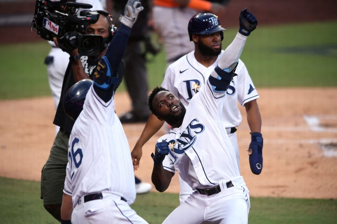 Tampa Bay Rays outfielder Randy Arozarena and first baseman Ji-Man Choi celebrate Arozarena's two-run home run during Game 7 of the ALCS on Saturday.