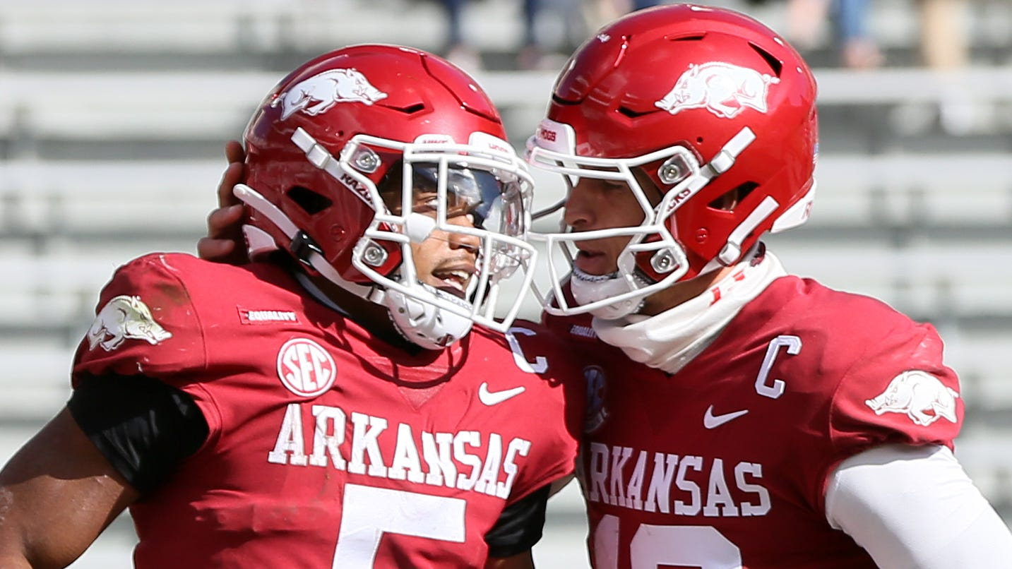 Arkansas running back Rakeem Boyb celebrates with quarterback Feleipe Franks after rushing for a touchdown during the first quarter against Ole Miss.