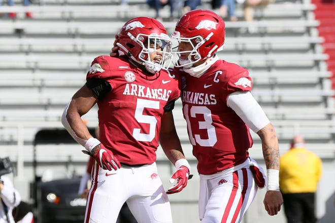 Arkansas running back Rakeem Boyb celebrates with QB Feleipe Franks after rushing for a first quarter touchdown against Ole Miss.