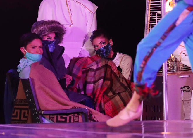 "Dancers keep warm off stage during a Cleveland Ballet performance of ""The Magic Flute"" Saturday at Stan Hywet."