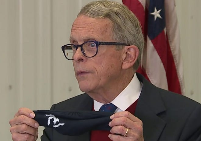 """After lambasting Akron Public Schools and a handful of other districts to offer in-person learning to all students by March 1, Gov. Mike DeWine took a more conciliatory tone Thursday, saying """"we just ask people to make the best effort."""""""