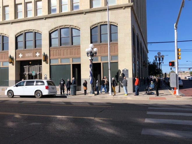 Individuals wait in line at the Santa Fe Building during the first week of early voting in Potter County.