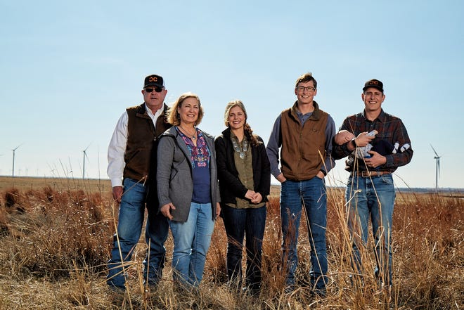 The Coffey family of Double C Cattle Company in Springer was named regional winner of the National Cattleman's Beef Association Environmental Stewardship Award Program. From left to right: Chuck Coffey Ruth Coffey, Sarah Armitage, Seth Coffey, and Aaron Coffey holds Noah Coffey.