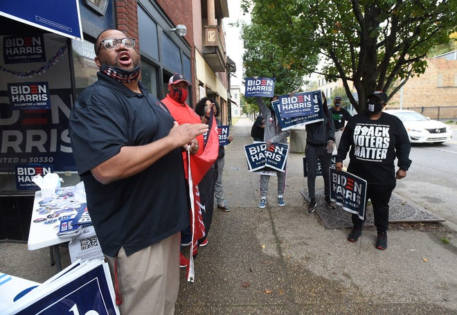 """Aliquippa Mayor Dwan Walker talks to Biden-Harris supporters outside the voter center on Franklin Avenue.  The """"Soul of the Nation"""" bus tour for the Democratic tandem passed through Aliquippa on Sunday afternoon."""