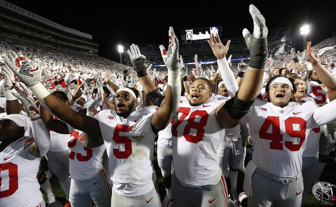 """Ohio State Buckeyes players sing """"Carmen Ohio"""" following the NCAA football game against the Penn State Nittany Lions at Beaver Stadium in University Park, Pa. on Sept. 29, 2018. The Buckeyes won 27-26. [Adam Cairns / Dispatch]"""
