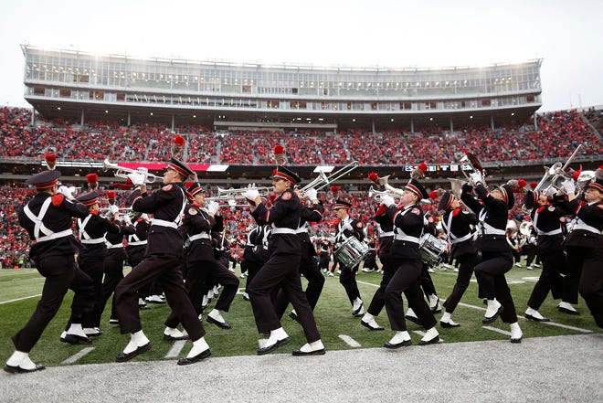 The Ohio State Marching Band performs Script Ohio prior to the NCAA football game against the Michigan Wolverines at Ohio Stadium in Columbus on Nov. 24, 2018. [Adam Cairns/Dispatch]
