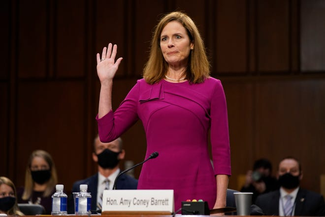 Supreme Court nominee Amy Coney Barrett is sworn in during a confirmation hearing before the Senate Judiciary Committee on Oct. 12 in Washington.