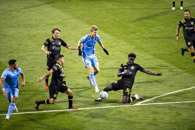 Crew defender Aboubacar Keita, right, blocks a shot attempt by New York City FC midfielder Keaton Parks. Keita said preventing an early goal was key for the Crew in a 3-1 win.