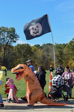 Crowds line up and make their way through this year's Trail of Treats at Deerassic Park.