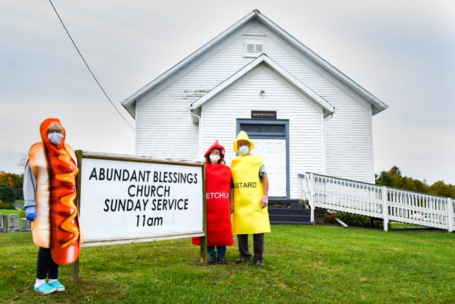 Pastor Dee Ryan, left, along with owners Nancy and Norm Gonder outside of Abundant Blessings Church in Cadiz Road.