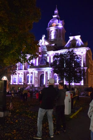 The Guernsey County Courthouse lights up the night with its Halloween themed light show. Only put on for three days, it's one of the first holiday events for Guernsey County.