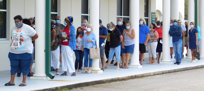 The Flagler County Supervisor of Elections Office registered 554 residents cast their ballots by 12:30pm on Monday, the first day of early voting in the county. [Erica Van Buren/News Journal]