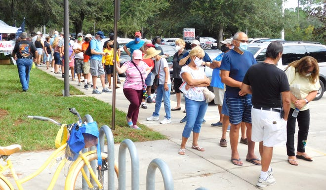 Flagler County voters gathered at the Flagler County Public Library in droves on Monday, the first day of early voting to cast their ballots.