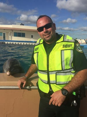 Flagler County Sheriff's Deputy Diego Gonzalez at Marineland in a picture on the Sheriff's Office Facebook.