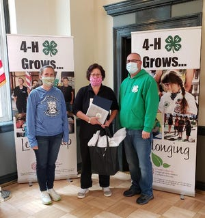 Alissa de Wit-Paul, center, has been named the 2020 Livingston County 4-H Volunteer of the Year. 4-H Educator Renee Hopkins is on the left and Youth Development Team Leader Mark Wittmeyer is on the right.