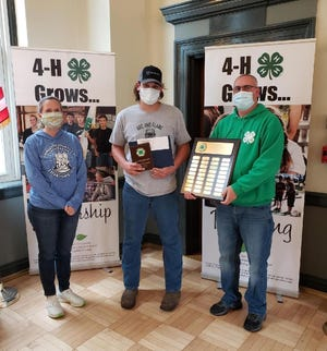 Ben Lyness, center, has been named the 2020 Livingston County Outstanding 4-H Member. 4-H Educator Renee Hopkins is on the left and Youth Development Team Leader Mark Wittmeyer is on the right.