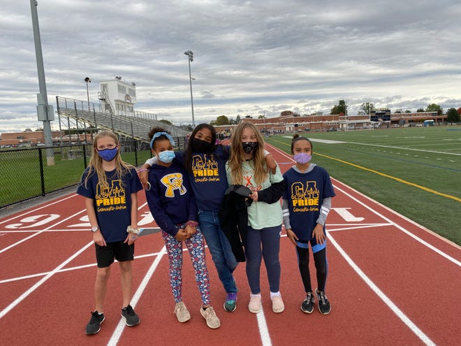 These fifth-graders showed their school spirit by wearing G-A shirts during the Race for Education.
