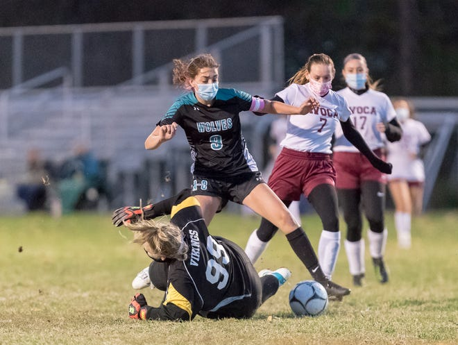 Arkport/Canaseraga's Julia Flaitz (9) looks to get a shot past sliding Avoca/Prattsburgh goalie Kayla Mills Saturday night.