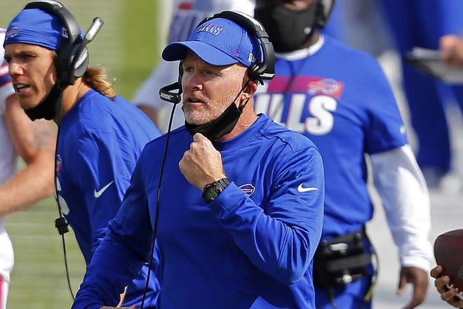 Buffalo Bills coach Sean McDermott pulls his mask down in this Sept. 13 file photo to give instructions on the sidelines during a game against the New York Jets in Orchard Park, New York. McDermott pays credit to experiences and advice he gained working under Kansas City coach Andy Reid, while the two were in Philadelphia, including getting fired by Reid in 2010, which McDermott says was the best thing to happen to his career.