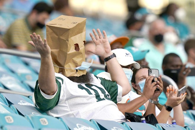 A New York Jets fans reacts to the team performance during the second half of Sunday's game against the Miami Dolphins in Miami Gardens, Florida.