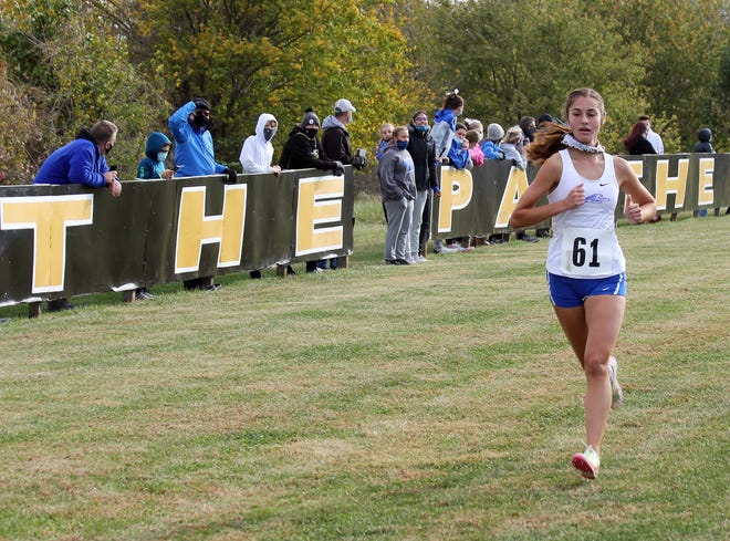Blue Springs South junior Mya Trober cruises to the finish line to repeat as conference champion at the Suburban Big Eight Championships. After winning five major meets during the season, including the district race, she stumbled at the Class 5 state meet, finishing one spot away from all-state honors. The Examiner's 2020 Girls Cross Country Runner of the Year vows to be even better as a senior.