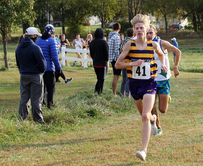 """Blue Springs' Brock Wooderson, front, runs to a victory in the Suburban Big Eight Championship. The once """"skinny freshman"""" finished his high school career with conference and district titles, a fifth-place state finish and a 38th place showing in a national meet. He is The Examiner's 2020 Boys Cross Country Runner of the Year."""