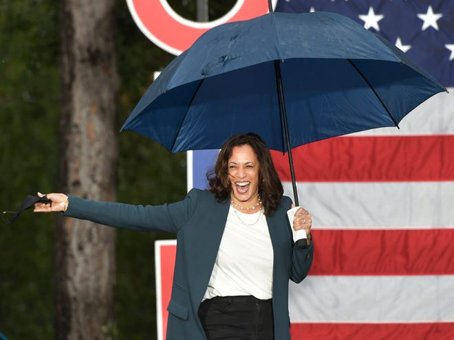 Vice-presidential candidate Kamala Harris addresses a drive-in rally Monday at the University of North Florida in Jacksonville.