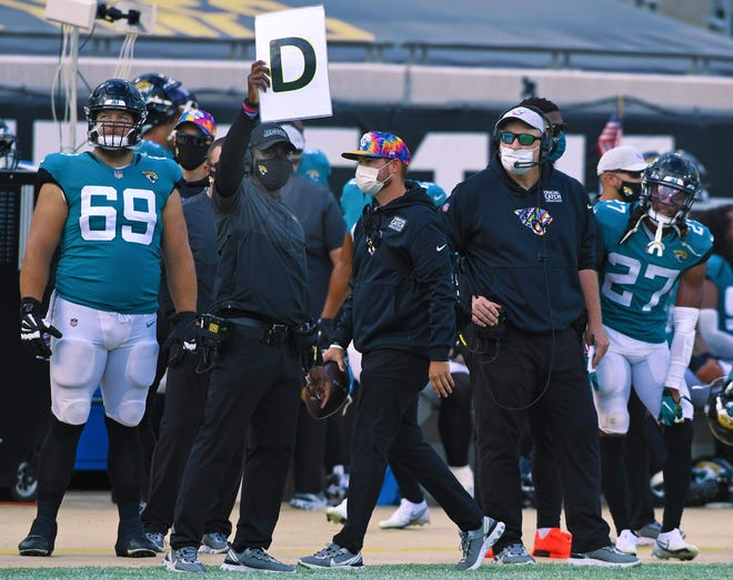 Jaguars coach Doug Marrone (right) watches the team during the waning minutes of Sunday's 34-16 loss to the Detroit Lions, at TIAA Bank Field.