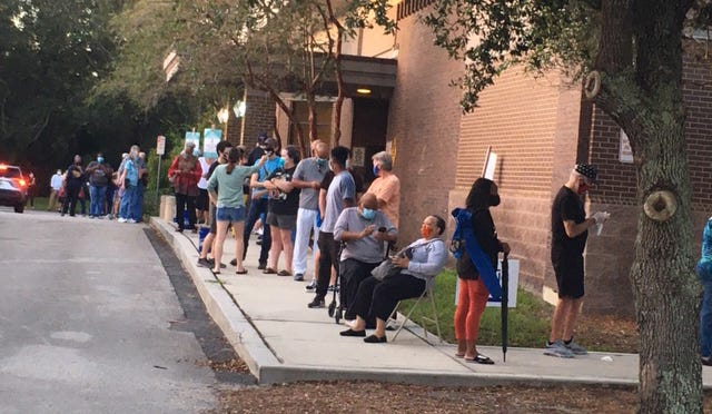 Hundreds of Duval County voters watched the sun rise Oct. 19 while patiently waiting to cast their ballots at Regency Square Branch Library.