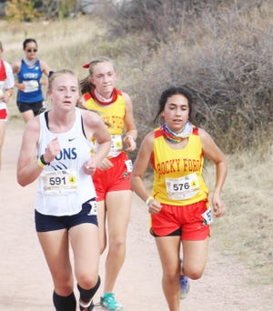Rocky Ford High School's Anahy Prieto (right) and Kailene Black (center) compete against a Lyons runner at the Class 2A State Meet Saturday in Colorado Springs. Prieto finished 57th and Black was 81st as the Lady Meloneers were 14th as a team.