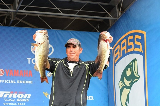 Ryan Lavigne with a pair of his day 2 stringer that weighed 22-05 that gave him the non-boater championship on Lake Conroe.