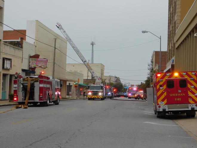 Fire crews in Sherman work to put out a fire in the former central appraisal district office in downtown Sherman Monday morning.