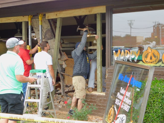 Crews in Denison work to shore up a wall in Nick's Family Restaurant in Denison Monday afternoon after the building was struck by a passenger truck. Officials with Denison Fire Rescue said some time after noon, the vehicle entered the restaurant by a few feet. What caused the truck to strike the building and the extent of injuries are currently unknown, department officials said.