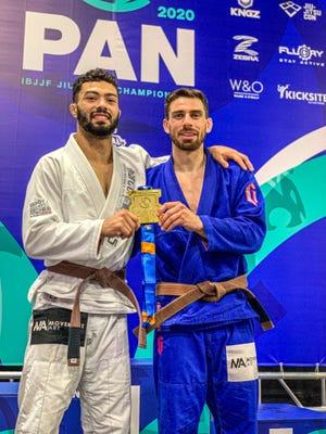 Nicholas Salles, left, and Daniel Maira, founders of the Movement Art Jiu-Jitsu academy in Richboro, celebrate their success in the IBJJF Pan-American Championships.