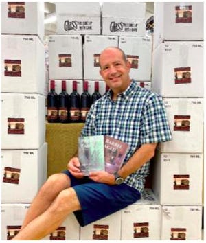 Businessman and owner of Gray Mart, Michael Gray, expresses his creative side by writing books and has a wine named after his mystery series.