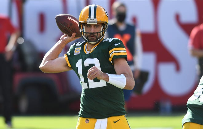 Green Bay Packers quarterback Aaron Rodgers (12) throws a pass aTampa Bay Buccaneers during the first half Sunday in Tampa.