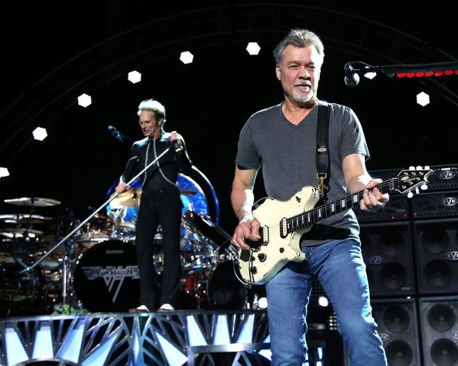 David Lee Roth, left, and Eddie Van Halen of Van Halen perform in August 2015 in Wantagh, N.Y. Van Halen died  Oct. 6 at age 65.