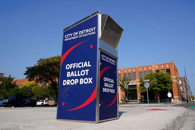 In this Thursday, Sept. 24, 2020, file photo, a ballot drop box is shown where voters can drop off absentee ballots instead of using the mail in Detroit. Seventeen states prohibit counting ballots cast by someone who subsequently died before the election, but 10 states specifically allow it. The law is silent in the rest of the country, according to research by the National Conference of State Legislatures.