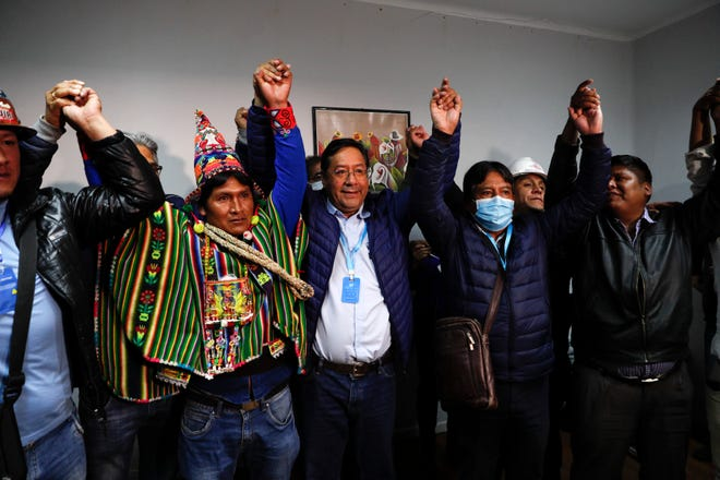Luis Arce, center, Bolivian presidential candidate for the Movement Towards Socialism Party, MAS, and running mate David Choquehuanca, second right, celebrate during a news conference where they claim victory after general elections in La Paz, Bolivia, on Monday.