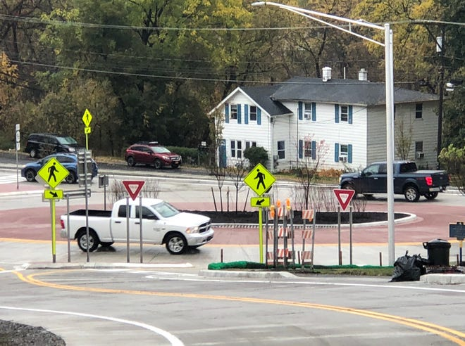 Motorists go round the roundabout that opened today at state Route 96 and Lynaugh Road in Victor.