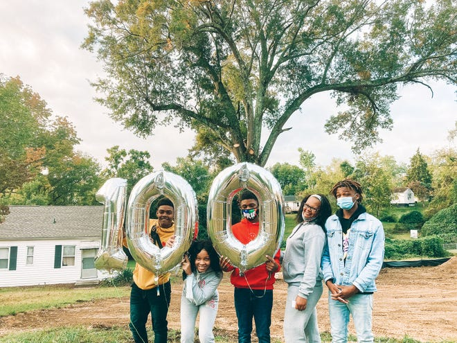 The Anderson family:Marlo Jr., Nicole, Laidailyon, Jeanette, and Ja'Lil express their excitement and gratitude for the opportunity to get a new home. The groundbreaking ceremony earlier this month marks the 100th home to be built by Habitat families and volunteers.