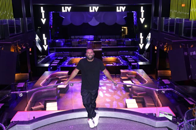 LIV owner David Grutman poses for a photograph at the nightclub, Wednesday, Oct. 14, 2020, in Miami Beach, Fla. LIV, one of Miami's most glamorous, star-studded nightclubs sits empty and quiet these days, a casualty of both the coronavirus outbreak and a power struggle between state and local government over how to contain the scourge. (AP Photo/Lynne Sladky)