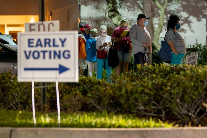 Voters wait in line to cast their ballots at the during the first day of early voting at the Palm Gardens Branch Library in Palm Beach Gardens , Florida on October 19, 2020. (GREG LOVETT / THE PALM BEACH POST)