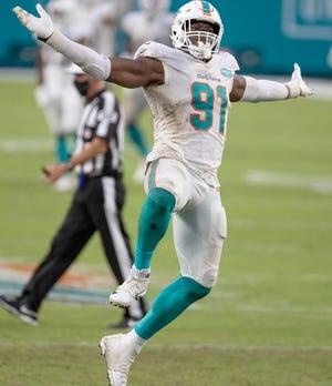 Dolphins defensive end Emmanuel Ogbah celebrates a sack of the Jets' Joe Flacco.