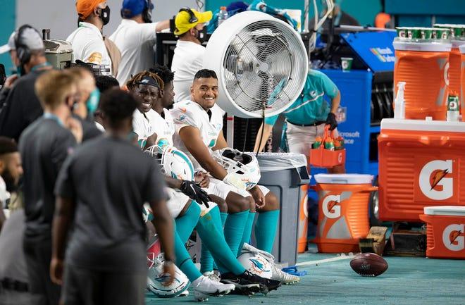 Miami Dolphins quarterback Tua Tagovailoa (1) prepares to enter game against the New York Jets at Hard Rock Stadium in Miami Gardens, October 18, 2020. (ALLEN EYESTONE / THE PALM BEACH POST)