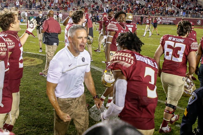 Florida State coach Mike Norvell celebrates with cornerback Jarvis Brownlee Jr. after the Seminoles upset North Carolina Saturday night in Tallahassee.