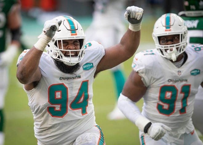 Dolphins defensive tackle Christian Wilkins celebrates a sack of the Jets' Joe Flacco.