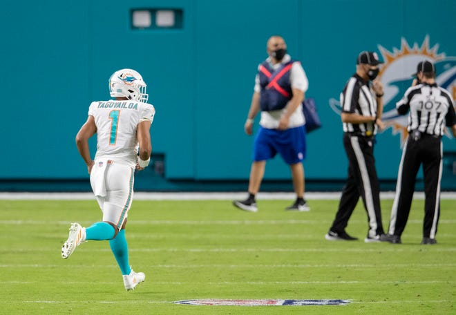 Miami Dolphins quarterback Tua Tagovailoa (1) enters the game for his first playing time as a Miami Dolphins against the New York Jets at Hard Rock Stadium in Miami Gardens, October 18, 2020. (ALLEN EYESTONE / THE PALM BEACH POST)